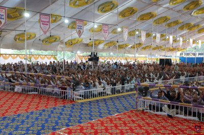Thousands of disciples from around the world fill the grand assembly