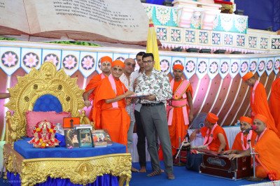 His Divine Holiness Acharya Swamishree Maharaj consecrates the ice cream prasad
