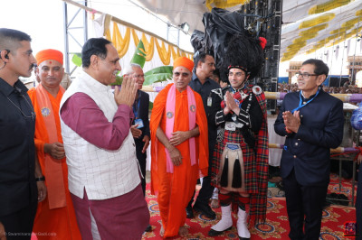 Sants and trustees of Shree Swaminarayan Mandir welcome Chief Minister of Gujarat Vijay Rupani to the grand assembly