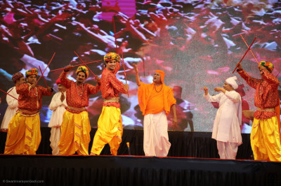 Disciples perform various percussion instruments and dandiya sticks during the evening performances
