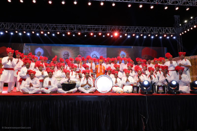 His Divine Holiness Acharya Swamishree Maharaj blesses disciples from London who took part in the evening devotional drama and dance performance finale