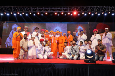 His Divine Holiness Acharya Swamishree Maharaj blesses all disciples who took part in the evening devotional drama and dance performances