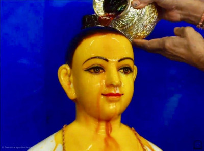 Lord Shree Swaminarayan bathed in saffron water