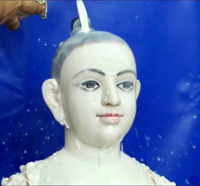 Lord Shree Swaminarayan bathes in milk