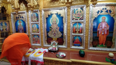 Sants write the divine name of the Lord on the new mandir flags