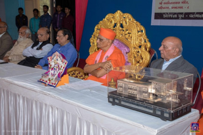 Acharya Swamishree Maharaj and guests watch the performance