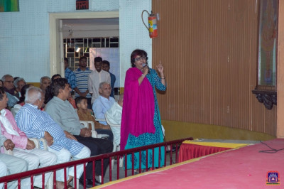 Actress Bhavini Jani, a former student of the college, gives a speech