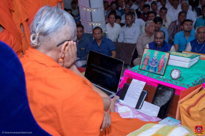 Acharya Swamishree Maharaj watches the mahotsav promo video