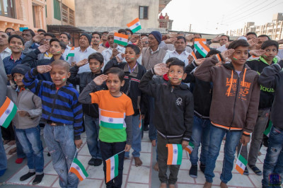 Children salute the flag on India Republic Day