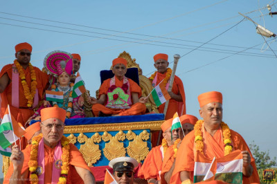 Lord Swaminarayan, Acharya Swamishree Maharaj and sants seated on a chariot during the procession