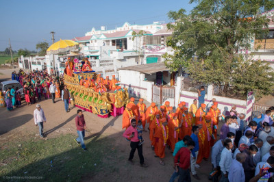 The procession continues through the town of Salal