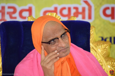 Acharya Swamishree Maharaj listens to the speeches
