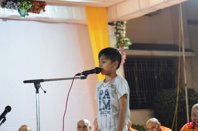 A young disciple gives a speech